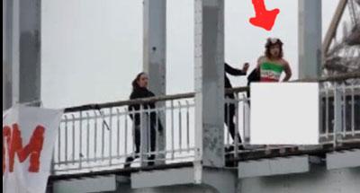 زنی که در اعتراض به سفر روحانی به پاریس برهنه و آویزان شد + فیلم