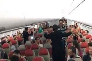 عکس رقص در پرواز مالزی به تهران